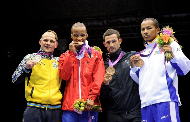 Murata and Usyk claim Olympic gold medals