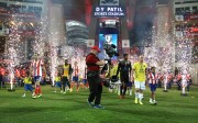 Atletico de Kolkata captain Jose Miguel Gonzalez Rey and Kerala Blasters FC captain Iain Hume lead their players out during the final of the Hero Indian Super League between Kerala Blasters FC and Atletico de Kolkata held at the D.Y. Patil Stadium, Navi Mumbai, India on the 2oth December 2014.  Photo by:  Shaun Roy / ISL/ SPORTZPICS